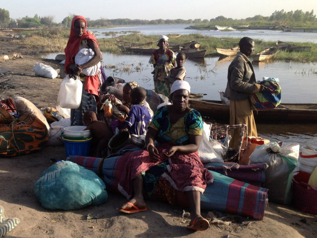 Members of a family gather their belongings as they wait to flee Nougboua after Nigeria's Boko Haram rebels carried out an attack on the village on Feb. 13, 2015.  Nigeria's Boko Haram rebels carried out their first attack Friday inside neighbouring Chad.